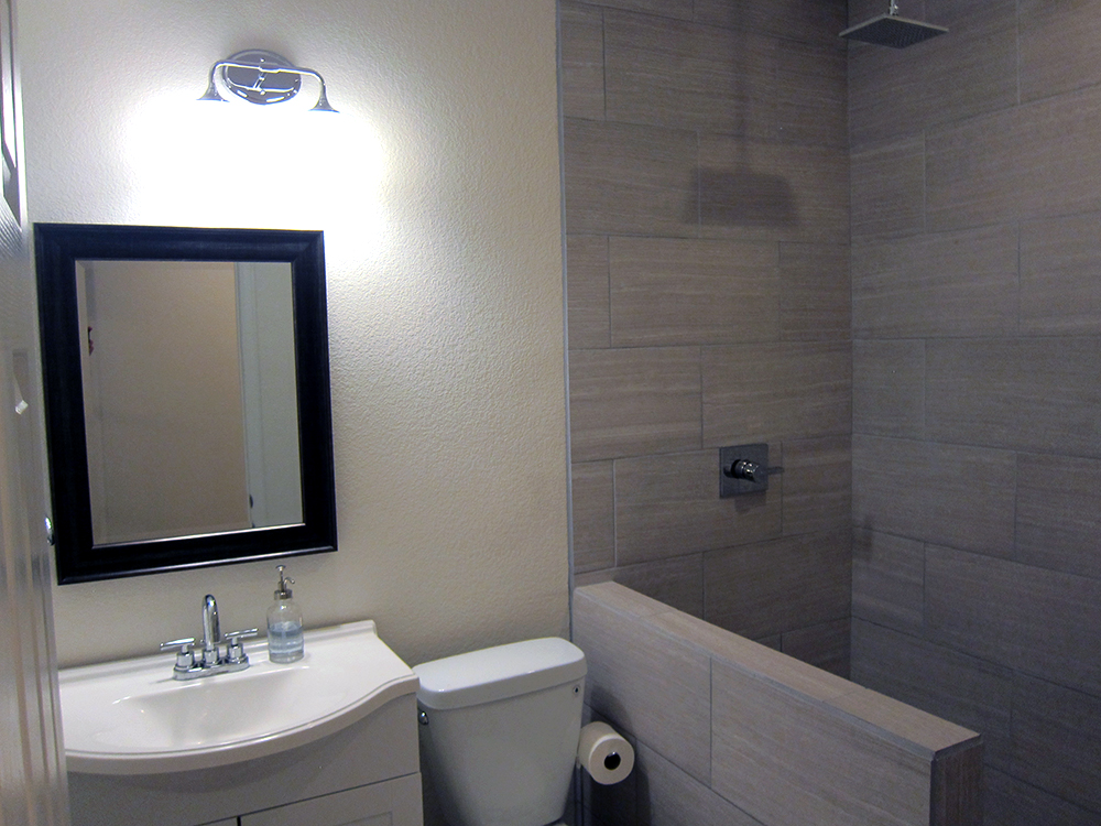 How to finish a basement bathroom before and after pictures for Bathroom designs basement