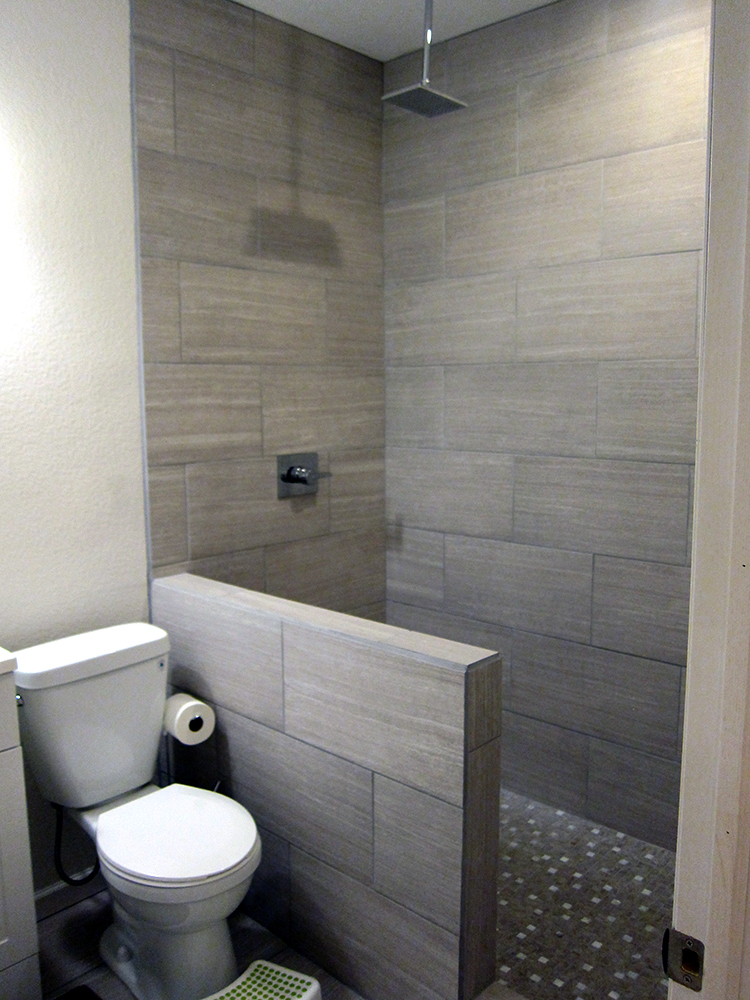 How to finish a basement bathroom before and after pictures for Basement bathroom tile ideas