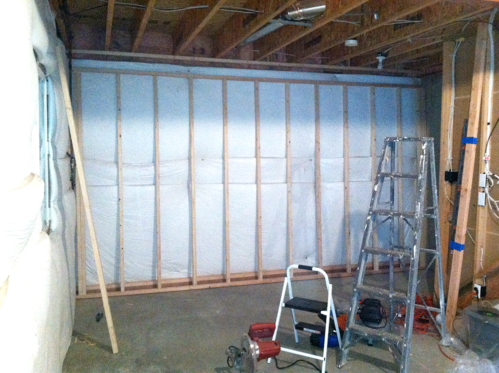 Framing basement walls how to build floating walls for Insulating basement floor before pouring