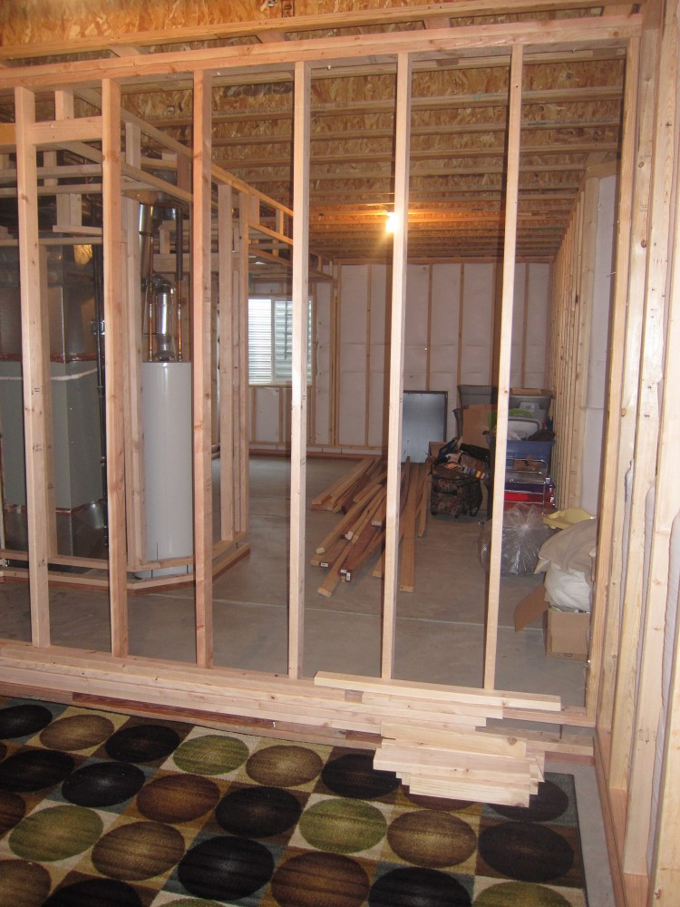 Before and after pictures finishing a basement bedroom for Framing interior basement walls